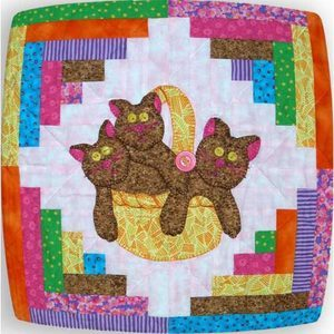 Log cabin quilt block with center applique